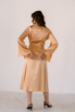Золотое платье на запах из шелка с рукавом в прокат и аренду в Киеве. Фото 5