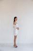 Белое платье мини с фантазийными рукавами в прокат и аренду в Киеве. Фото 2