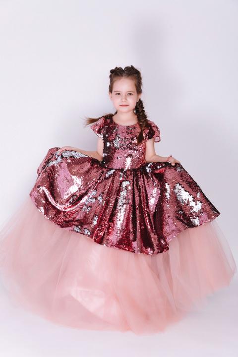 Детское розовое платье в пайетки с бантом