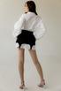 Платье-рубашка белого цвета со съемной черной баской в прокат и аренду в Киеве. Фото 5