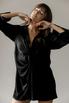 Черное шелковое платье мини с длинным рукавом и глубоким декольте в прокат и аренду в Киеве. Фото 2