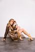 Кофейное шелковое платье мини с длинным рукавом и глубоким декольте в прокат и аренду в Киеве. Фото 1